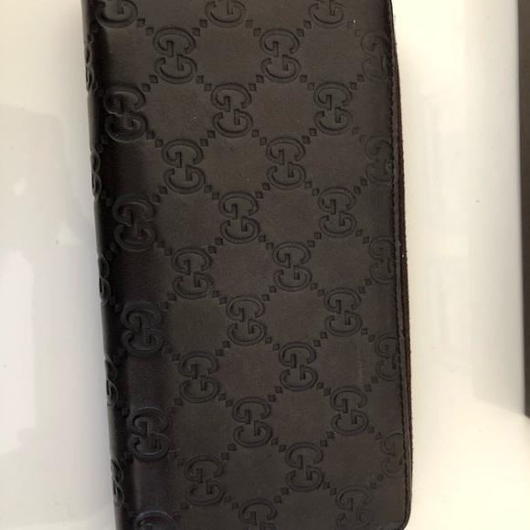 Gucci Handbags - Gucci GG zipper wallet